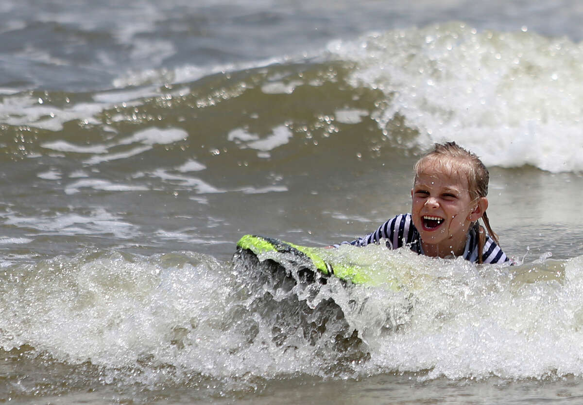 Harlee Lee-Faulk, 5, body surfs at the site of the first beach restoration project on Galveston island.