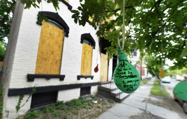 A balloon personalized to Grace Halpin hangs from a tree near 520 Second Avenue Tuesday, May 16, 2015 in Troy, N.Y., where she was rescued from the burning building.  (Skip Dickstein/Times Union) Photo: SKIP DICKSTEIN / 00031990A