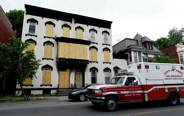 A Troy Fire Department ambulance passes by 520 Second Avenue Tuesday, May 16, 2015 in Troy, N.Y., where Grace Halpin was rescued from the burning building.  (Skip Dickstein/Times Union) Photo: SKIP DICKSTEIN / 00031990A