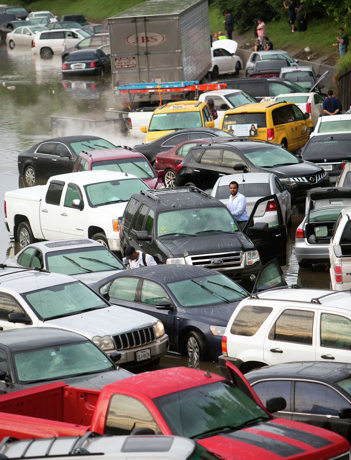 Motorists are stranded along I-45 along North Main in Houston after storms flooded the area, Tuesday, May 26, 2015. Overnight heavy rains caused flooding closing some portions of major highways in the Houston area. (Cody Duty/Houston Chronicle via AP) ORG XMIT: TXHOU101