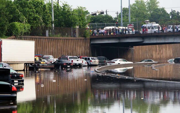 Motorists are  stranded along I-45 along North Main  in Houston after storms flooded the area, Tuesday, May 26, 2015. Overnight heavy rains caused flooding closing some portions of major highways in the Houston area. (Cody Duty/Houston Chronicle via AP) ORG XMIT: TXHOU103 Photo: Cody Duty / Houston Chronicle