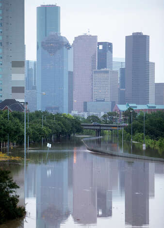 Memorial Drive  in Houston is flooded after storms flooded the area, Tuesday, May 26, 2015. Overnight heavy rains caused flooding closing some portions of major highways in the Houston area. (Cody Duty/Houston Chronicle via AP) ORG XMIT: TXHOU104 Photo: Cody Duty / Houston Chronicle