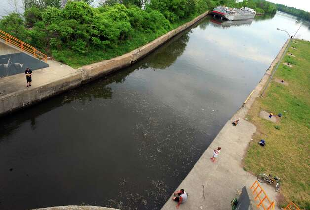 People fish along the entrance to Lock 7 of the New York State Canal System on Tuesday May 26, 2015, on the Mohawk River in Niskayuna, N.Y. An audit by Comptroller Tom DiNapoli found that state canal system locks haven?t been inspected in years. (Michael P. Farrell/Times Union) Photo: Michael P. Farrell / 00032019A
