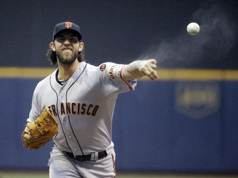 San Francisco Giants starting pitcher Madison Bumgarner throws before the first inning of a baseball game against the Milwaukee Brewers Tuesday, May 26, 2015, in Milwaukee. (AP Photo/Morry Gash) Photo: Morry Gash, Associated Press