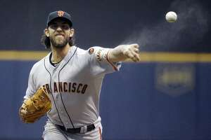 Giants' Bumgarner reacts aggressively to Carlos Gomez's frustration - Photo