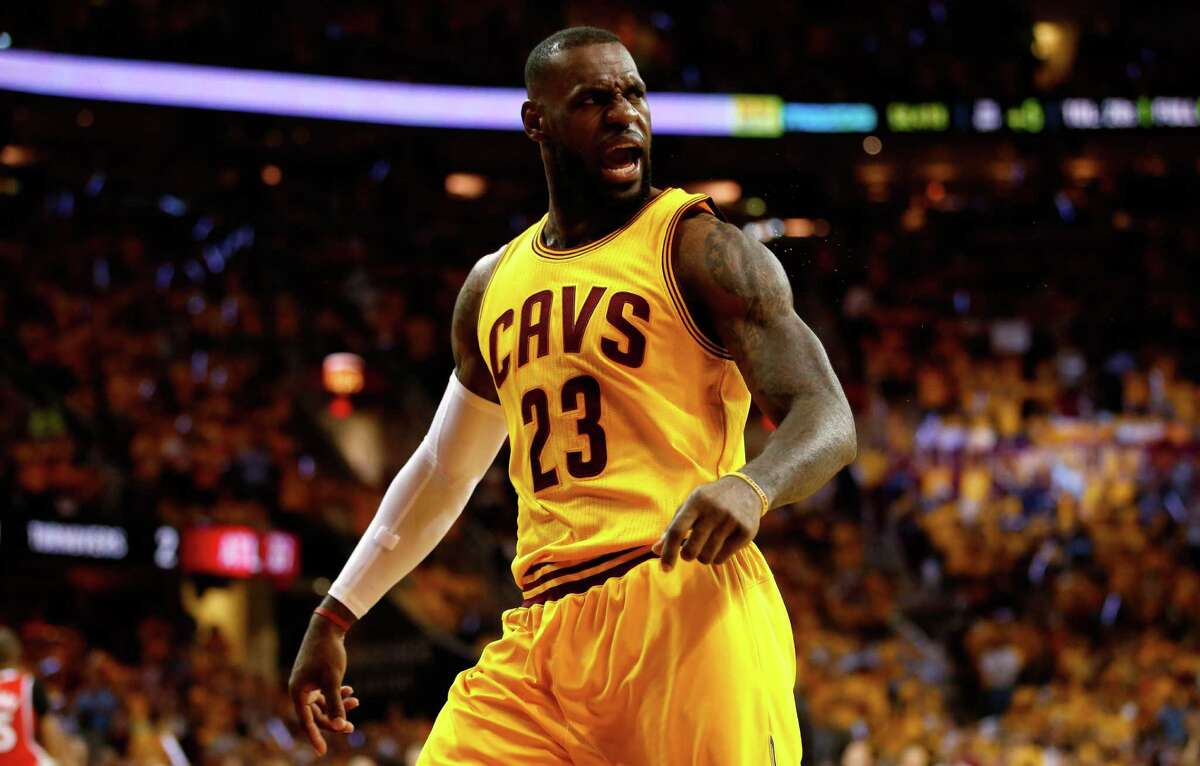 CLEVELAND, OH - MAY 26: LeBron James #23 of the Cleveland Cavaliers reacts after a play in the first quarter against the Atlanta Hawks during Game Four of the Eastern Conference Finals of the 2015 NBA Playoffs at Quicken Loans Arena on May 26, 2015 in Cleveland, Ohio. NOTE TO USER: User expressly acknowledges and agrees that, by downloading and or using this Photograph, user is consenting to the terms and conditions of the Getty Images License Agreement. (Photo by Gregory Shamus/Getty Images) ORG XMIT: 554941871