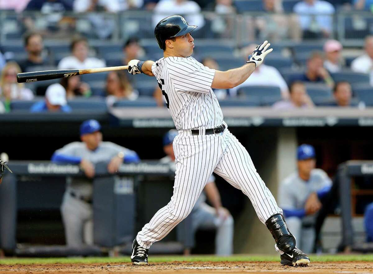NEW YORK, NY - MAY 26: Mark Teixeira #25 of the New York Yankees hits a two run homer in the first inning against the Kansas City Royals on May 26, 2015 at Yankee Stadium in the Bronx borough of New York City. (Photo by Elsa/Getty Images) ORG XMIT: 538581231