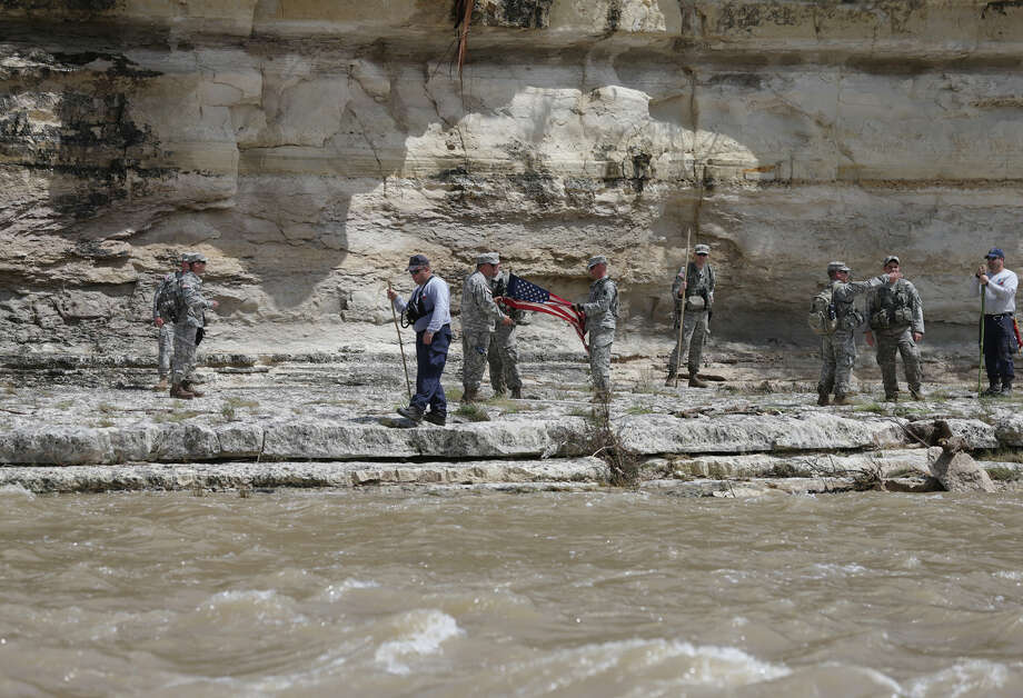 National Guard members participate in search and rescue efforts as homeowners clean up on Flite Acres Road along the Blanco River in Wimberley. Photo: Tom Reel / San Antonio Express-News