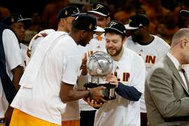 CLEVELAND, OH - MAY 26: James Jones #1 and Matthew Dellavedova #8 of the Cleveland Cavaliers hold the trophy after defeating the Atlanta Hawks during Game Four of the Eastern Conference Finals of the 2015 NBA Playoffs at Quicken Loans Arena on May 26, 2015 in Cleveland, Ohio. The Cavaliers defeated the Hawks 118-88. NOTE TO USER: User expressly acknowledges and agrees that, by downloading and or using this Photograph, user is consenting to the terms and conditions of the Getty Images License Agreement.  (Photo by Gregory Shamus/Getty Images)