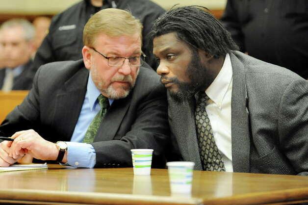 Herman Robinson, right, confers with assistant public defender Sven Paul during Robinson's trial on Friday, April 24, 2015, at Schenectady County Court in Schenectady, N.Y. Robinson will be sentenced 100 years to life for repeatedly raping a girl over a several year span and then delivering and killing the baby they conceived. (Cindy Schultz / Times Union) Photo: Cindy Schultz / 00031584A