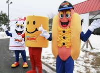 Sonic mascots wave to motorists at new Sonic Drive-In site on Troy Schenectady Road Thursday, March 5, 2015, in Colonie, NY.  (John Carl D'Annibale / Times Union)