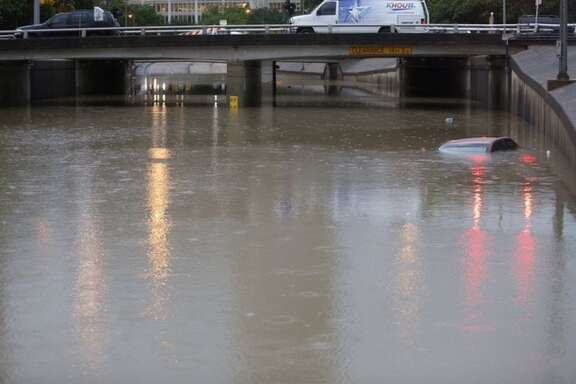 Allen Parkway at Montrose still under water day after torrential downpours sweep Houston area.