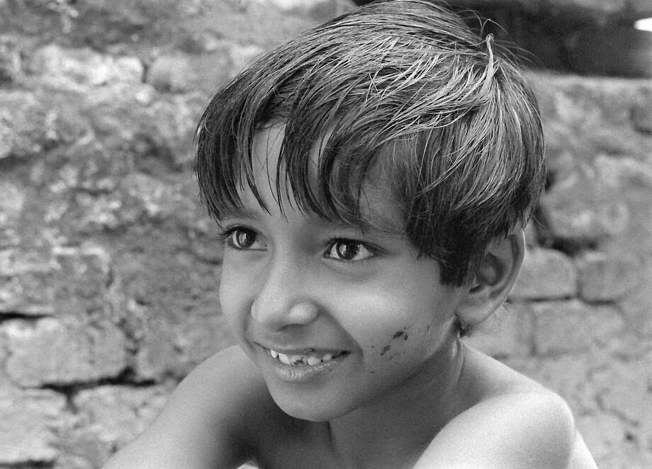 "Subir Banerjee stars as Apu, in ""Pather Panchali,"" the first installment of Satyajit Ray's legendary Indian films ""The Apu Trilogy."" Photo: Janus Films / ONLINE_YES"