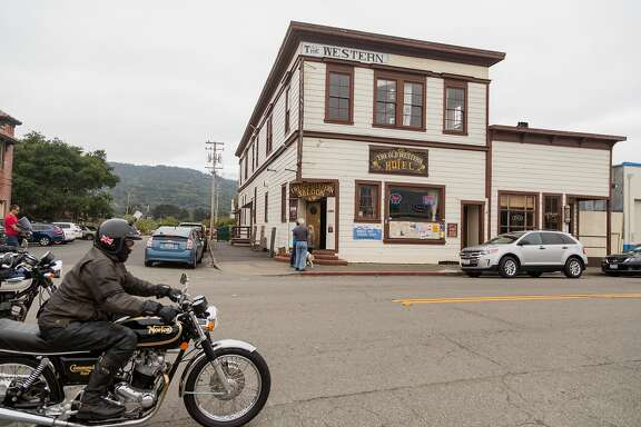 A motorcyclist rides past The Old Western Hotel and Saloon in Point Reyes Station, Calif., Saturday, May 23, 2015.