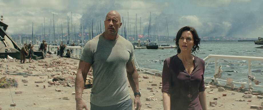 "This photo provided by Warner Bros. Pictures shows Dwayne Johnson (left) as Ray, and Carla Gugino as Emma, in a scene from the action thriller, ""San Andreas."" Photo: Warner Bros. Pictures, Associated Press"