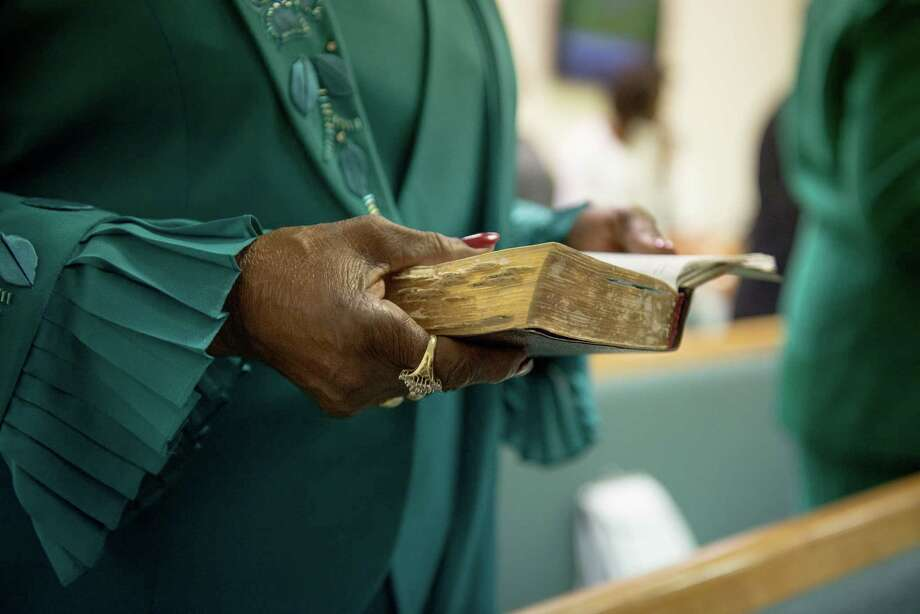 Marjorie Campbell, a member of Wheatley Heights first Baptist Church for over 50 years holds her bible during service in San Antonio on Sunday, May 17, 2015. Wheatley Heights celebrated its last mortgage payment with a ceremonial note burning. The church's original location at 1052 F St. was destroyed in the great flood of 1998. The church's congregation, under the director of Pastor L.A. Williams Jr., were able to raise $450,000 over 12 years to pay off their mortgage three years earlier than expected. Photo: Matthew Busch, For San Antonio Express-News / For San Antonio Express-News / © Matthew Busch