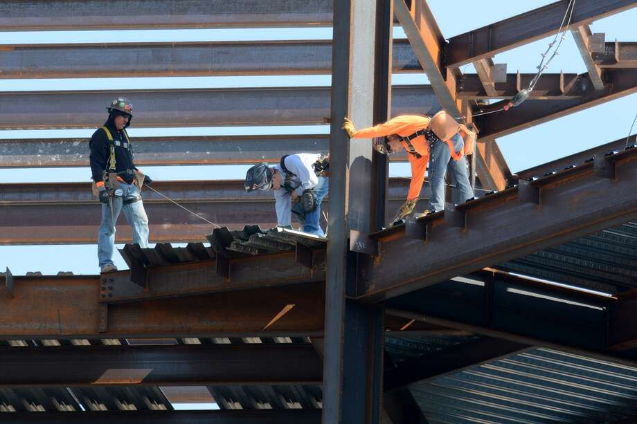 Construction continues on CHI St. Luke's new $110 milllion hospital in Springwoods Village. Photo: Jerry Baker, Freelance