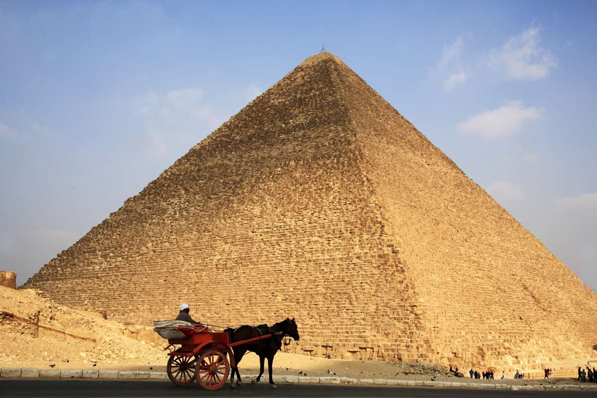 Slaves? Most people believe the Pyramids -- the Great Pyramid was built around 2530 B.C. -- were built by slaves. Recent evidence shows they were built by free skilled workers who lived on site and ate very well.