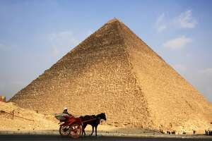 Horse carriage in Giza Pyramid Complex with Great Pyramid in the background.