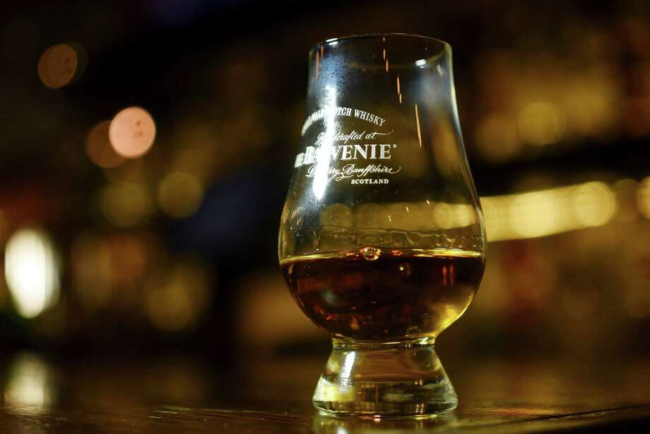 The Balvenie Scotch is served in a Glencairn glass at Bar 1919. Photo: Billy Calzada /San Antonio Express-News / San Antonio Express-News