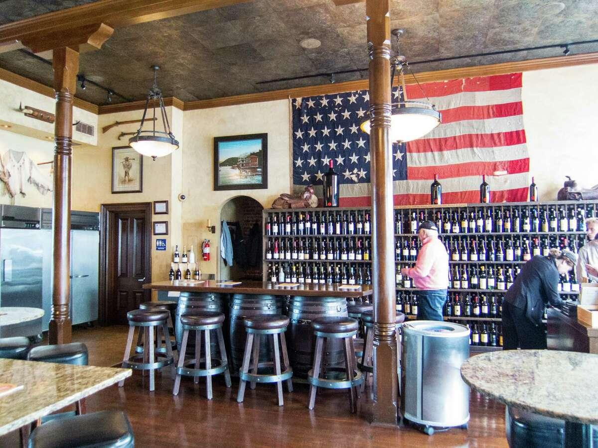 The wine wall and interior of the Bounty Hunter Wine Bar & Smokin' BBQ in Napa, Calif.