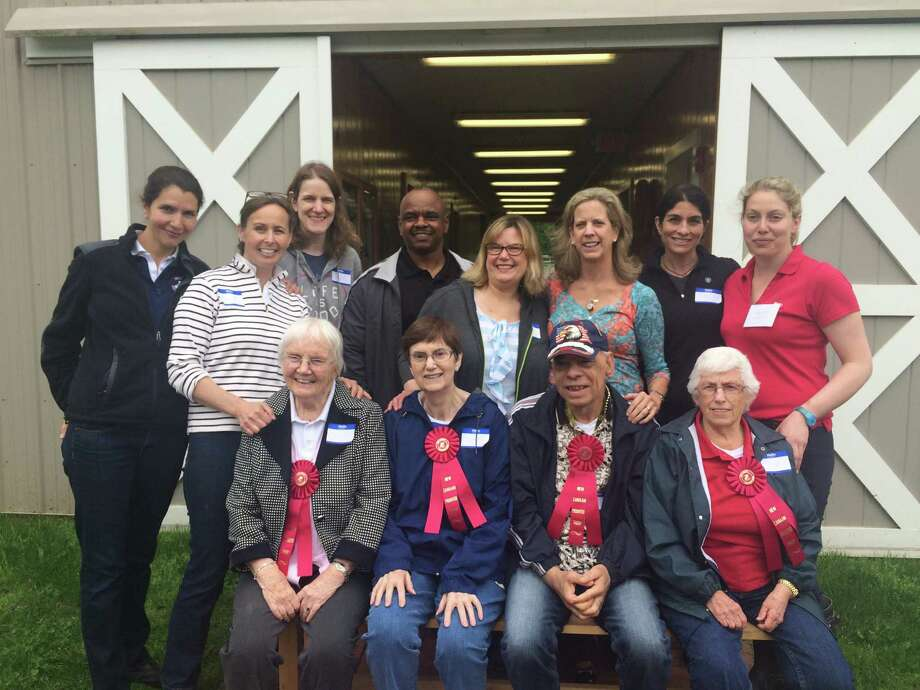 Participants and volunteers at New Canaan Mounted Troop and Waveny LifeCare Network's recent therapeutic four-week Equine Care pilot program Photo: Contributed Photo / New Canaan News