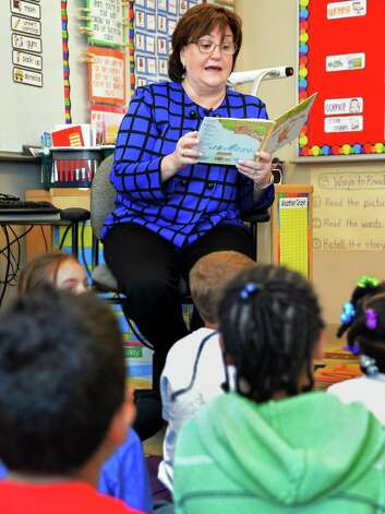 Newly appointed NYS Education Commissioner Maryellen Elia reads to first graders during a visit a Pine Hills Elementary School Wednesday May 27, 2015 in Albany, NY.  (John Carl D'Annibale / Times Union) Photo: John Carl D'Annibale / 00032035A