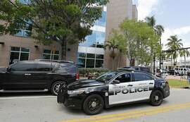 MIAMI BEACH, FL - MAY 27:  A Miami Beach police car sits outside the headquarters of CONCACAF after it was raided by FBI agents on May 27, 2015 in Miami Beach, Florida.  The raid is part of an international investigation of FIFA where nine FIFA officials and five corporate executives were charged with racketeering, wire fraud and money laundering conspiracies.