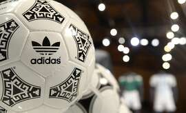 """FILES - Picture taken on May 8, 2014, shows former Adidas official football FIFA World Cup ball's that are presented during the company's shareholders' meeting in Fuerth, southern Germany. Adidas, the German maker of sportswear and equipment, said on May 5, 2015, it confirmed its full-year earnings targets after business got off to a """"good start"""" in the first three months.  AFP PHOTO / CHRISTOF STACHECHRISTOF STACHE/AFP/Getty Images"""