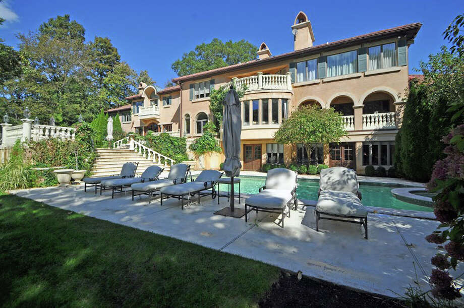 The Westport mansion long owned by Michael Bolton, listed for sale by Higgins Group Real Estate. Photo: Contributed Photo / Westport News
