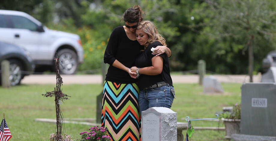 Mourners gather Wednesday May 27, 2015 at the Devine Evergreen Cemetery for the graveside service of Devine High School graduating senior Alyssa Ramirez. Ramirez died in last weekend's storms after her car stalled in rising floodwaters near Devine, Texas. Photo: John Davenport, San Antonio Express-News / ©San Antonio Express-News/John Davenport