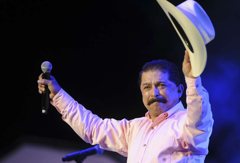 Emilio Navaira acknowledges applause after performing at the Tejano Music Awards at the Alamodome in San Antonio on Saturday, Aug. 18, 2012. Photo: Billy Calzada, San Antonio Express-News