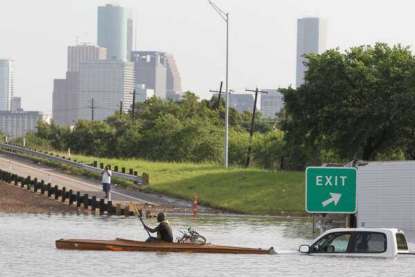 Veon McReynolds kayaks  the flooded waters on 288 and McGregor in the Medical Center on Tuesday, May 26, 2015 in Houston, TX  (Photo: Thomas B. Shea/For the Chronicle)