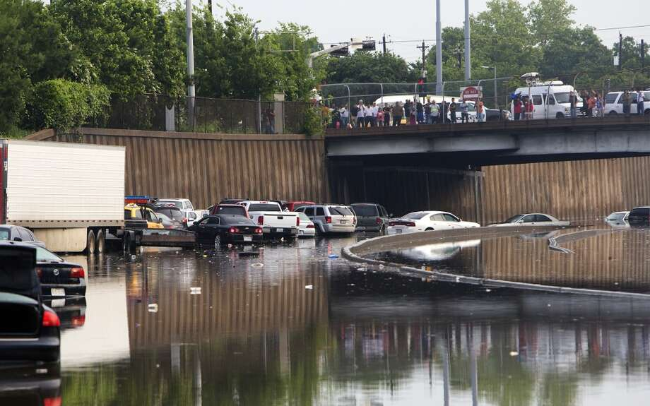 Motorists are seen stranded along I-45 along North Main after storms flooded the area, Tuesday, May 26, 2015, in Houston. (Cody Duty / Houston Chronicle) Photo: Houston Chronicle
