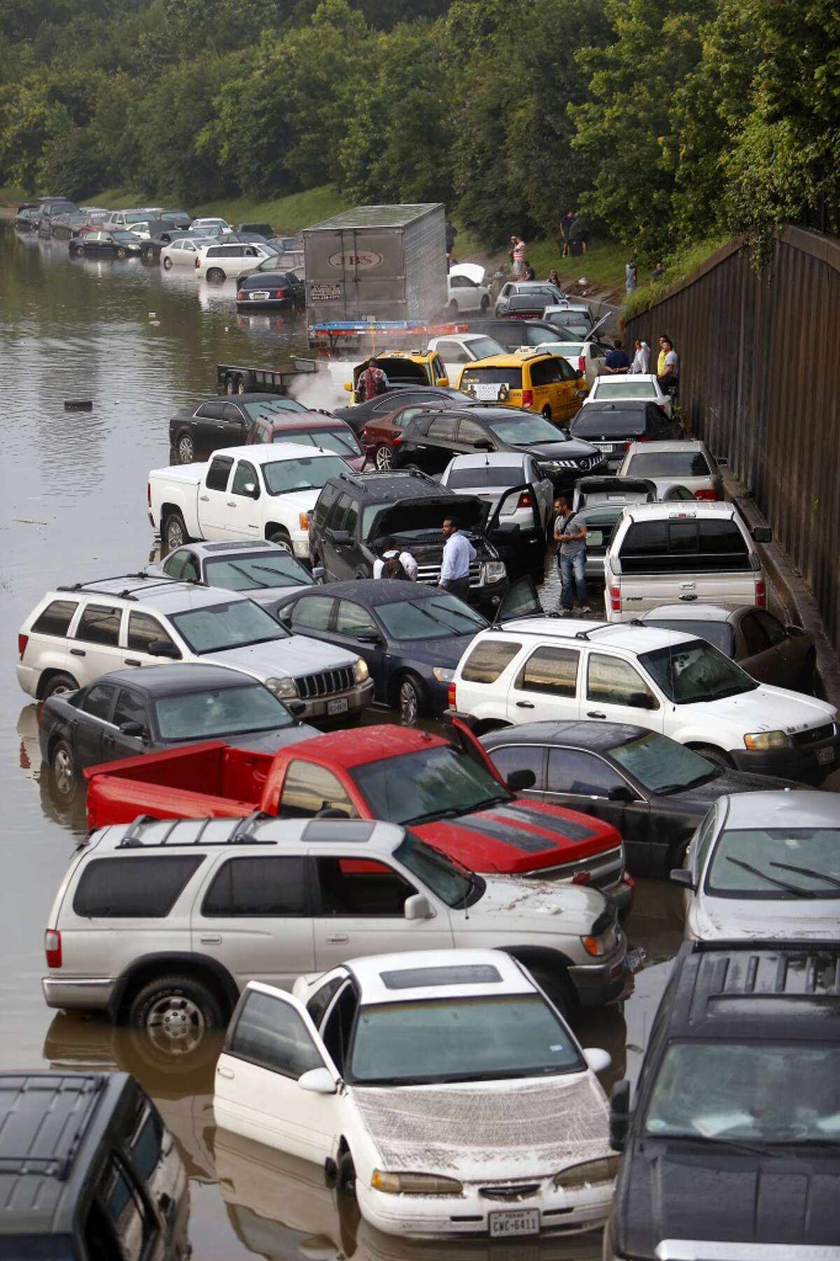 Motorists are seen stranded along I-45 along North Main after storms flooded the area, Tuesday, May 26, 2015, in Houston. (Cody Duty / Houston Chronicle)