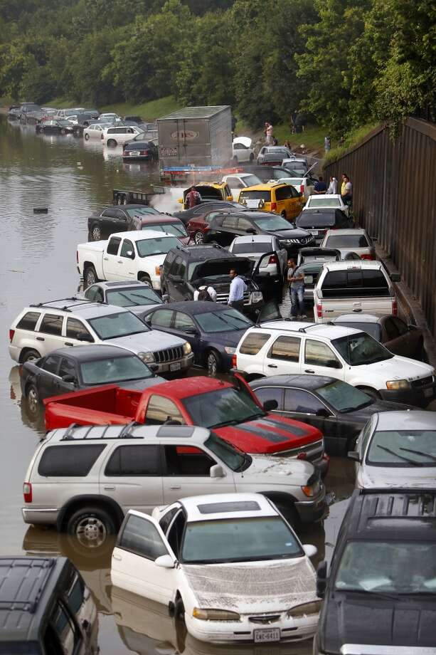 Motorists are seen stranded along I-45 near North Main after storms flooded the area, Tuesday, May 26, 2015, in Houston. (Cody Duty / Houston Chronicle) Photo: Houston Chronicle