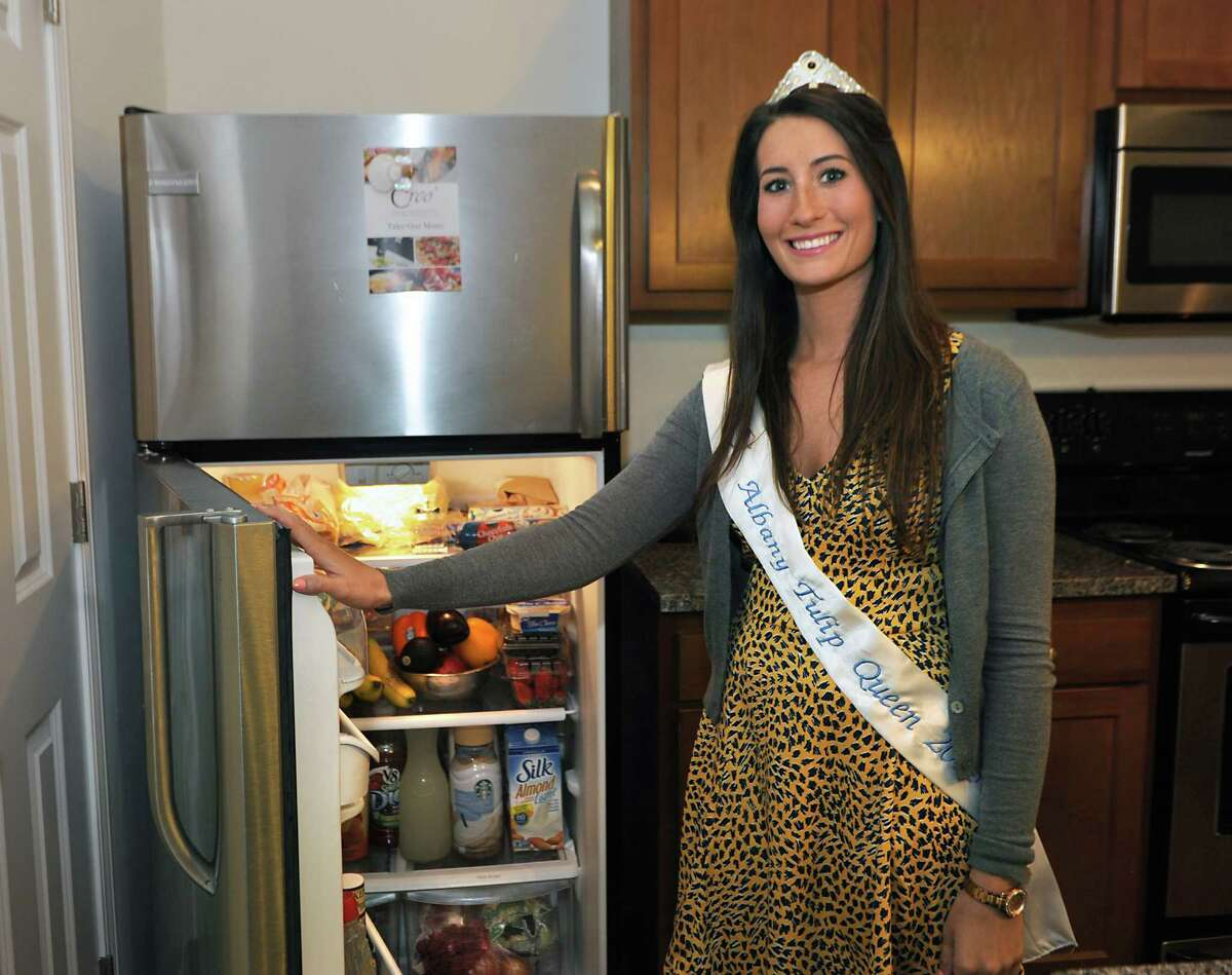 Alexandra Cronin stands next to her refrigerator at her home on Wednesday, May 20, 2015 in Selkirk, N.Y. Alexandra is the most recently crowned Tulip Queen. (Lori Van Buren / Times Union)