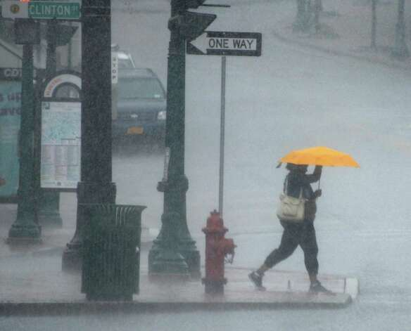 A pedestrian crosses State Street during a rain shower Wednesday May 27, 2015 in Schenectady, NY.  (John Carl D'Annibale / Times Union) Photo: John Carl D'Annibale