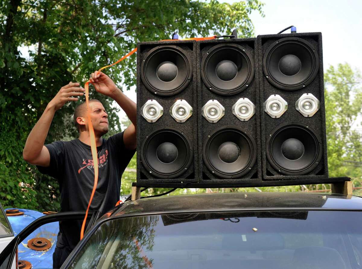 Guillermo Encarnacion, 21, of Danbury, Conn. a mechanic at Brothers Auto Sale in Danbury rigged up a powerful sound system in his brothers car with speakers on the roof as well as the back seat, trunk and other places. Photo Wednesday, May 27, 2015.