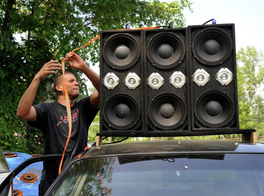 Guillermo Encarnacion, 21, of Danbury, Conn. a mechanic at Brothers Auto Sale in Danbury rigged up a powerful sound system in his brothers car with speakers on the roof as well as the back seat, trunk and other places. Photo Wednesday, May 27, 2015. Photo: Carol Kaliff / The News-Times