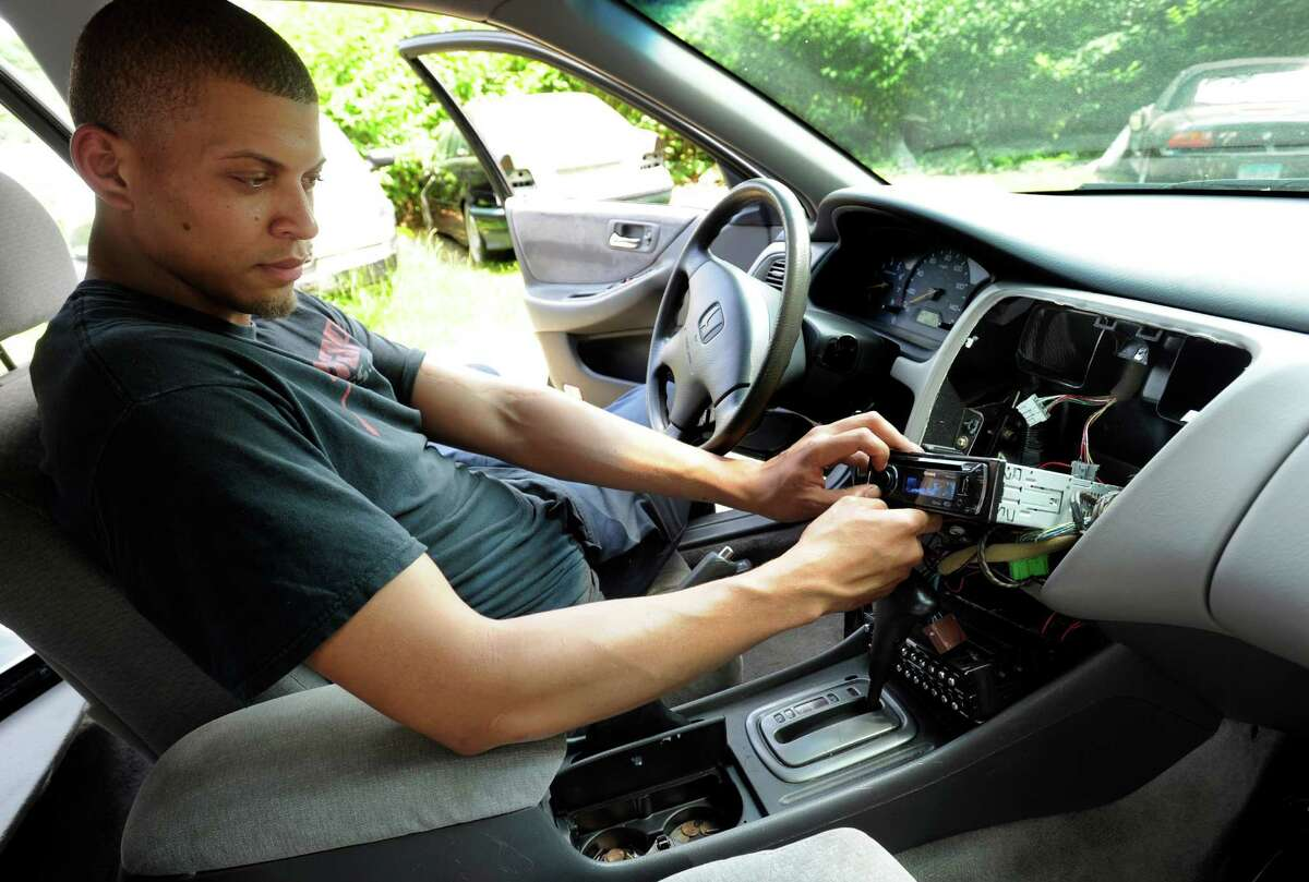 Guillermo Encarnacion, 21, of Danbury, Conn. a mechanic at Brothers Auto Sale in Danbury rigged up a powerful sound system in his brothers car including customized equipment near the drivers seat. Photo Wednesday, May 27, 2015.