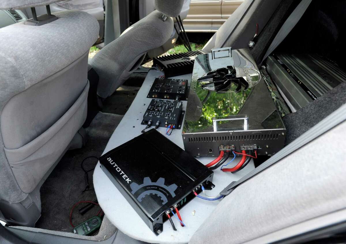 Guillermo Encarnacion, 21, of Danbury, Conn. a mechanic at Brothers Auto Sale in Danbury rigged up a powerful sound system in his brothers car. The backseat is replaced by sound equipment. Photo Wednesday, May 27, 2015.