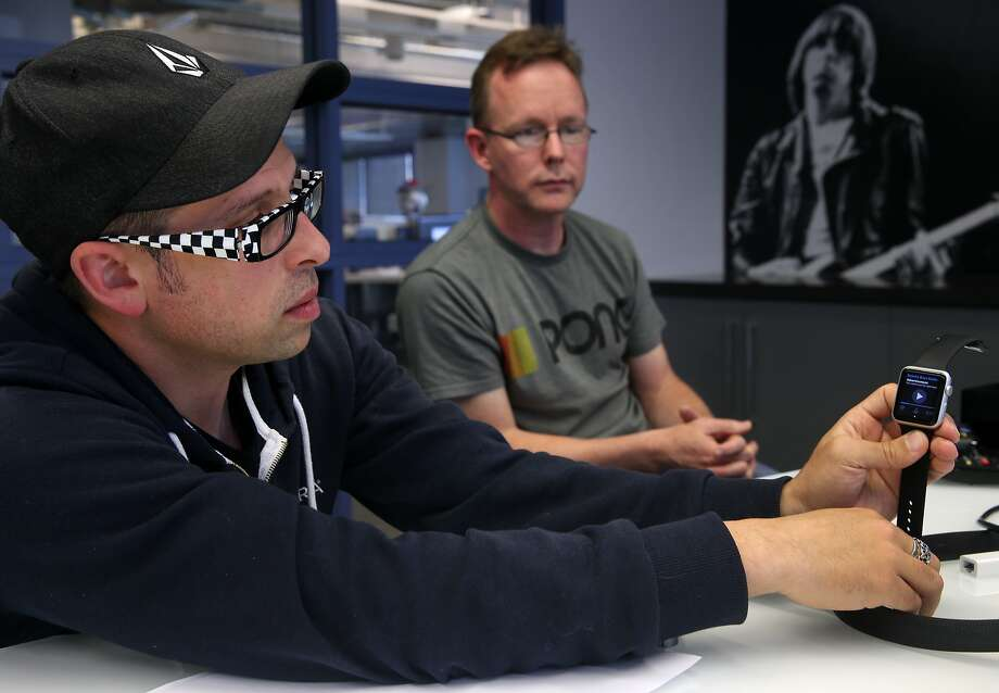 Pandora's lead product designer Jason Tusman and director of device engineering Carl Edwards demo the streaming music service on new platforms, including the Apple Watch, in Oakland, Calif. on Wednesday, May 27, 2015. Photo: Paul Chinn, The Chronicle