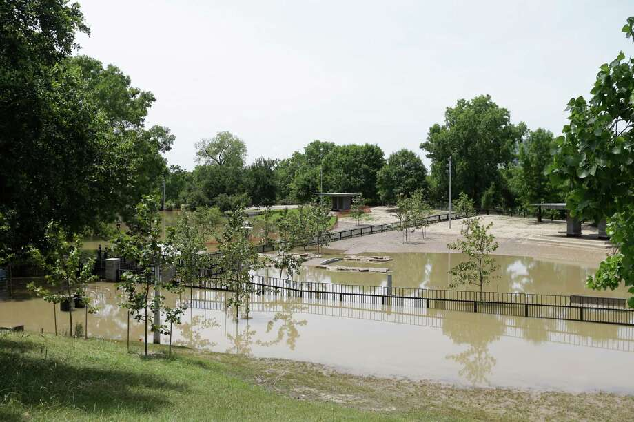 But on May 27, Buffalo Bayou was far out of its banks. And by design, the park took on its other identity: As a stormwater retention pond. Photo: Melissa Phillip, Houston Chronicle / © 2015  Houston Chronicle