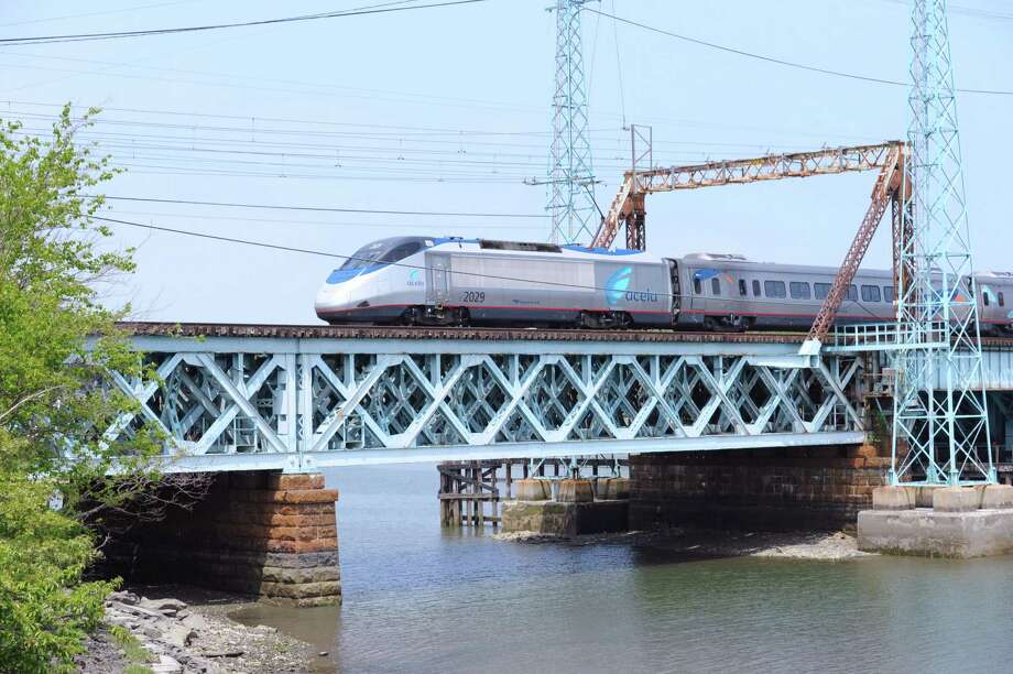 A train travels on the Cos Cob railroad bridge over the Mianus River in Greenwich, Conn., Wednesday, May 27, 2015. Photo: Bob Luckey / Greenwich Time