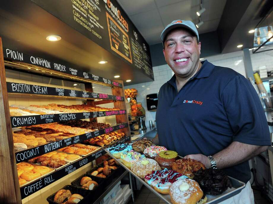 Owner Jason Wojnarowski stands behind the counter at Donut Crazy, on River Road in Shelton, Conn., across from Sports Center of Connecticut.  Photo: Autumn Driscoll / Connecticut Post