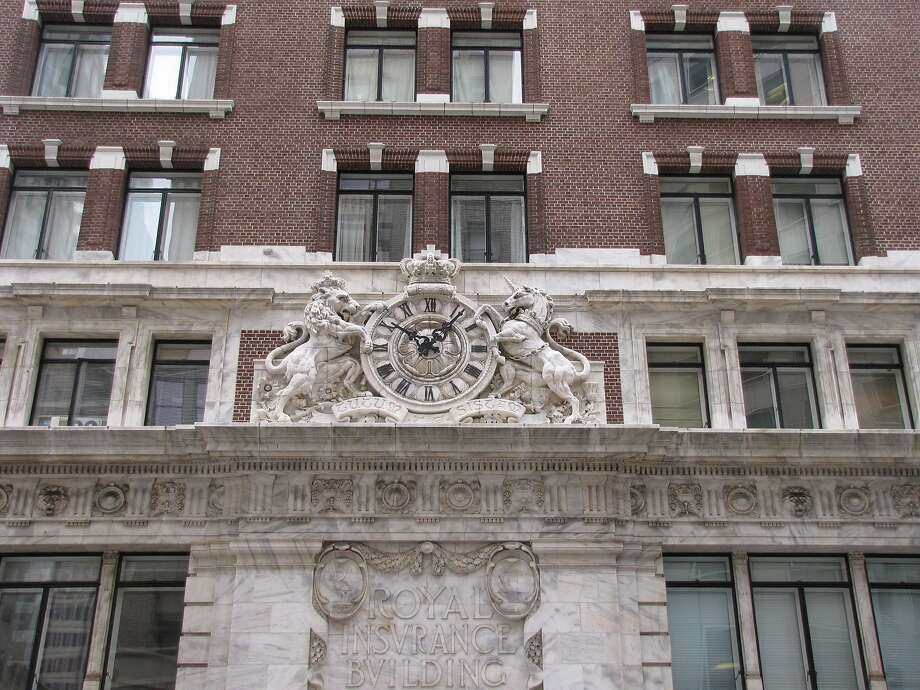 The carved marble clock being fought over by a lion and unicorn at 201 Sansome St. was built in 1907 for the Royal Globe Insurance Co. and is now a residential structure. Photo: John King, The Chronicle