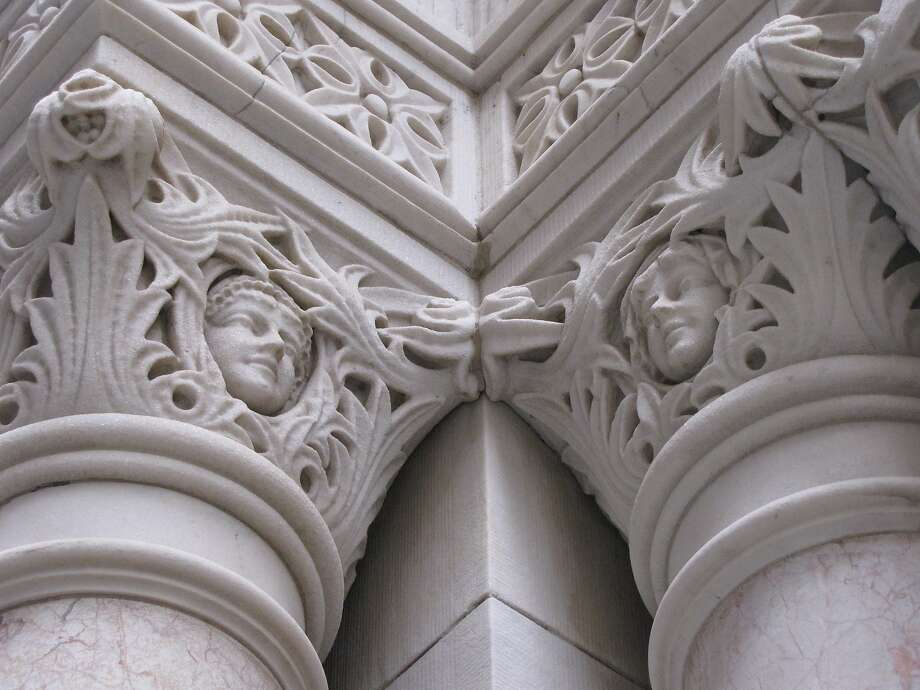 Cherubs top the columns framing the entrance to the Mills Building at 220 Montgomery St., a landmark with roots going back to 1891. Photo: John King, The Chronicle
