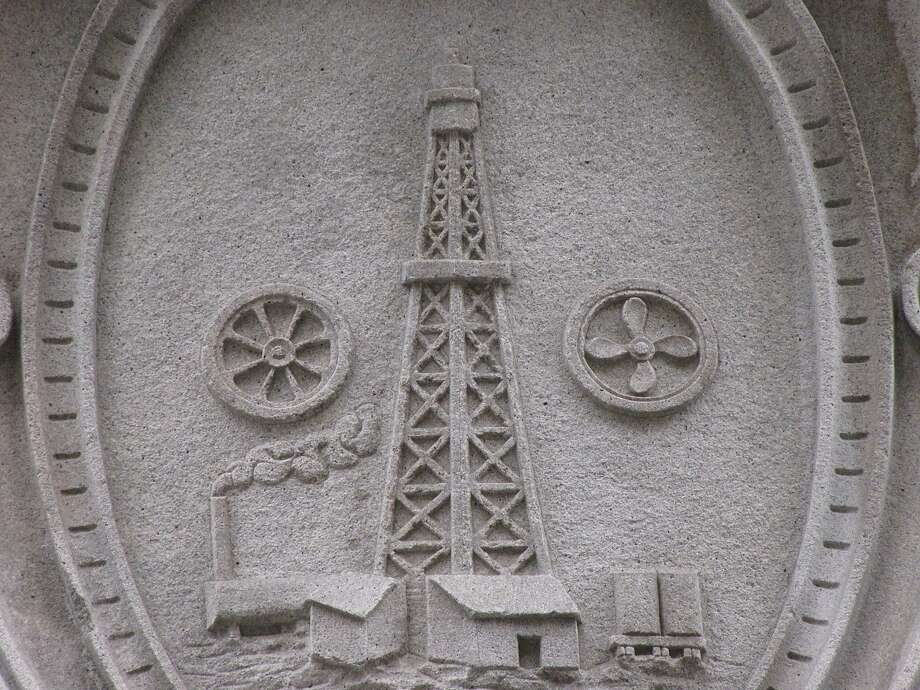 The carved plaque of an oil well above the entrance to 225 Bush, built in 1922 as the headquarters to, yes, Standard Oil Co. The architect: George Kelham. Photo: John King, The Chronicle