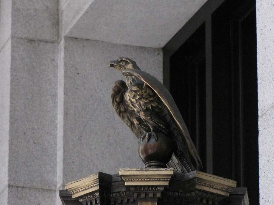 This bird of prey stands watch over the entrance to 465 California St., the Merchant's Exchange Building from 1903. Photo: John King, The Chronicle